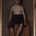 Nude study of boy, sitting on box. 1896